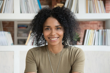 Smiling young african american woman looking at camera webcam