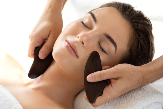 Woman during Chinese traditional massage - Gua Sha