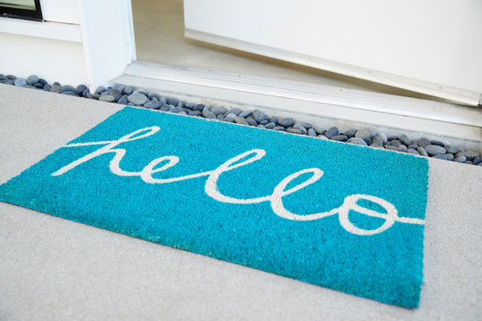 Doormat Outside Open Front Door Of House