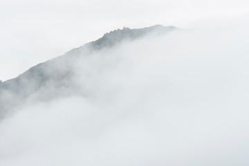 Fog hanging on the mountains;  near Juneau, Alaska