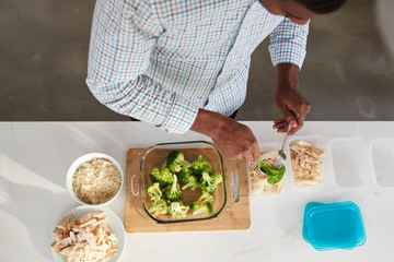 Overhead View Of Man In Kitchen Preparing High Protein Meal