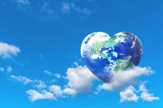 Earth in Heart shape on the white clound with blue sky, Love and Save the World for the Next Generation and Earth day concept, Elements of this image furnished by NASA