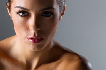 A Lovely Brunette Model Poses In A Studio Environment