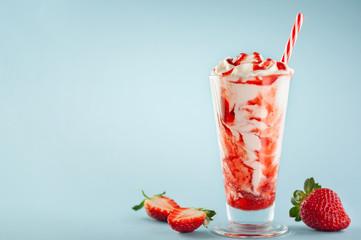 Strawberry milkshake with whipped cream.