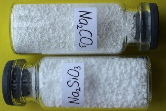 Sodium carbonate and sodium silicate in glass jars.