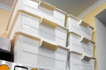 Stack of plastic storage boxes Wall mural