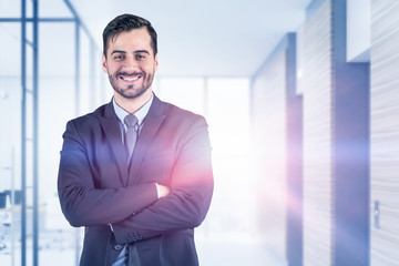 Smiling confident businessman in office
