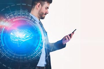 Businessman with smartphone, brain interface