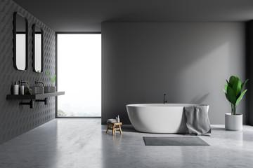 Gray bathroom interior, tub and sinks
