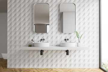 White tiled bathroom interior, double sink