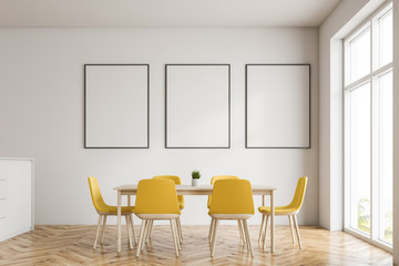 White dining room with poster gallery