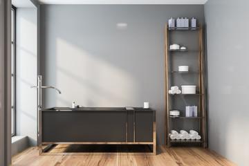 Gray bathroom interior, tub and shelves