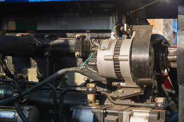 DC generator in the engine compartment of the mini tractor