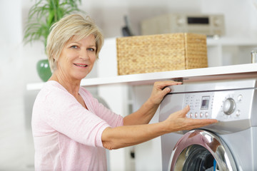 woman next to a washing machine