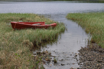 Small rowing boat by the lake