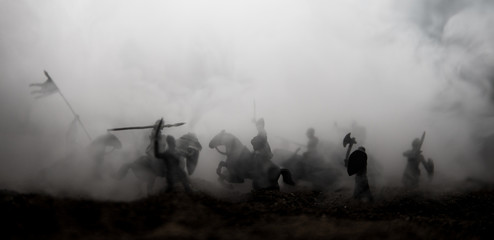 Medieval battle scene with cavalry and infantry. Silhouettes of figures as separate objects, fight...
