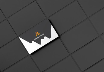 Business Card Layout with Black and Orange Elements