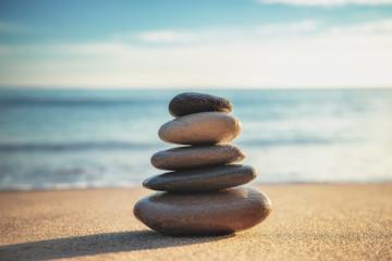 Stones balance on the beach. Zen meditation. Yoga.