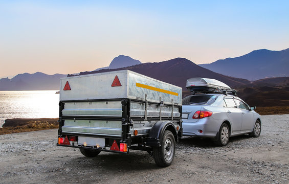 Car trailer by the sea