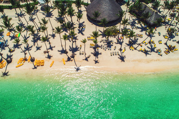 Island beach in Caribbean resort, Bavaro, Dominican Republic. Summer vacation. Aerial drone view over the seascape.
