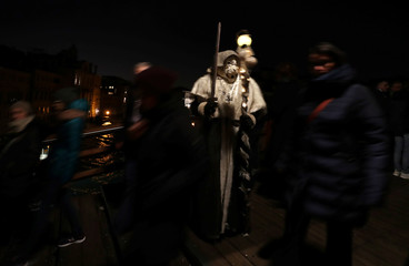 A masked reveller takes part in the Venice Carnival in Venice