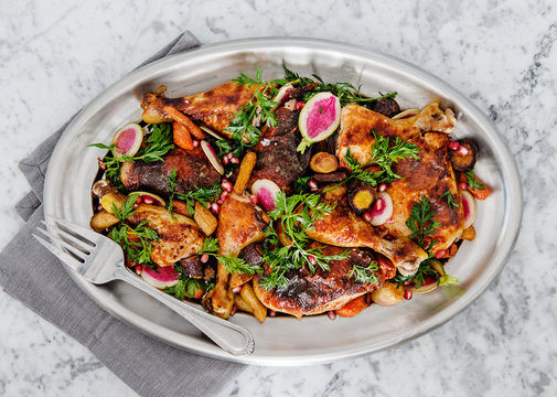 Roasted Chicken with carrots, radishes, and pomegranate
