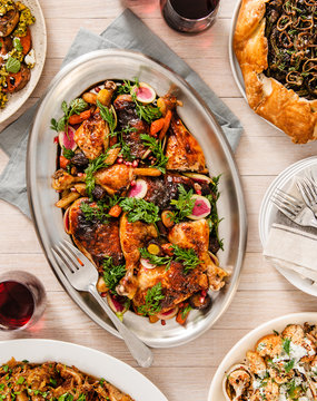 Holiday table setting with Roasted Chicken side dishes and red wine
