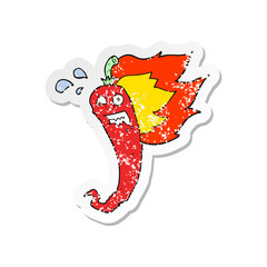 retro distressed sticker of a hot chilli pepper cartoon
