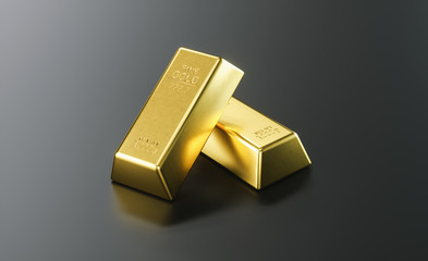 two pieces of gold bar stack up on a black background