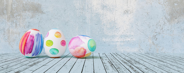 Painted easter eggs for Easter in front of a blue grunge background wall, including copy space, banner size