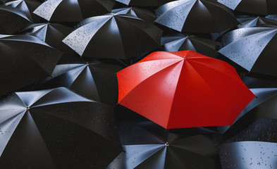 Red umbrella between black ones, individuality and difference concept