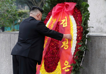 North Korean leader Kim Jong Un attends a wreath laying ceremony at Monument to War Heroes and Martyrs in Hanoi