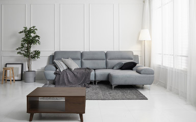 Scandinavian style livingroom with fabric sofa, sofa table. morning image with plant. sofa table on the lug.