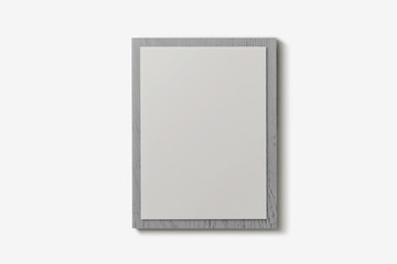 Blank white paper on wooden clipboard on soft gray background.