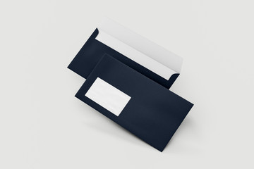 Blank envelopes in dark blue, isolated on white with soft shadows. back side.mockup.