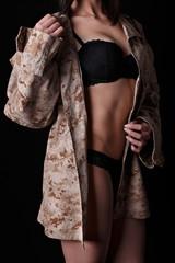 beautiful naked girl in camo shirt posing in studio