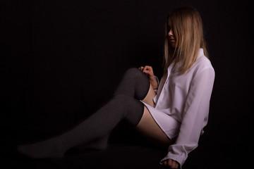 beautiful naked girl in white shirt posing in studio