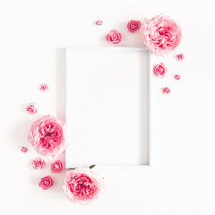 Flowers composition. Photo frame, rose flowers on white background. Valentines day, mothers day, womens day, spring concept. Flat lay, top view, copy space, square