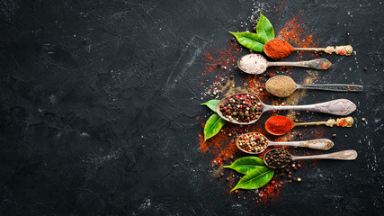 Wall Mural - Colored pepper and sea salt. Top view. On the old background. free space for your text.