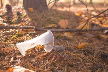 Illegal discarded coffee mug