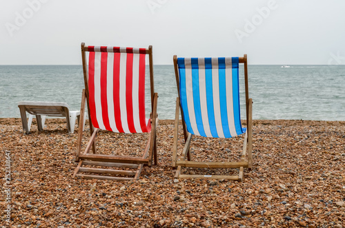 Pleasing Two Beach Chairs With Red Blue And White Stripes On Beach Caraccident5 Cool Chair Designs And Ideas Caraccident5Info