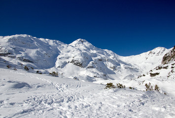 Beautiful Winter Landscape of the Mountain covered with snow under the blue and clear sky and snow field. Ski touring and snoshoeing paradise. Slovenia, Julian Alps, Komna