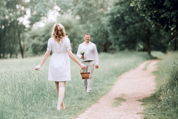happy husband and wife walking towards each other
