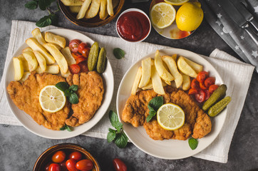 Homemade german schnitzel with pickles