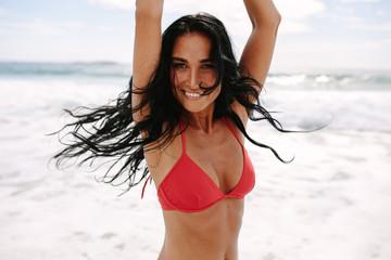 Joyous woman enjoying on the beach