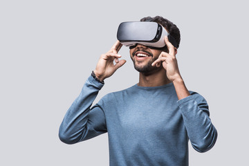 Young man using virtual reality headset. VR, future, gadgets, technology concept