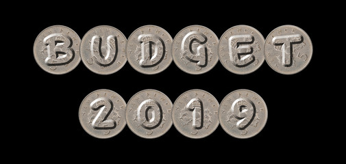 BUDGET 2019 – Five new pence coins on black background