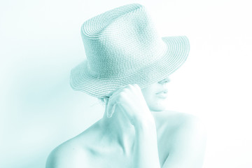 portrait of a girl in a hat toned with bare color, bright, for texture and background