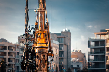 Machine for drilling holes and city background