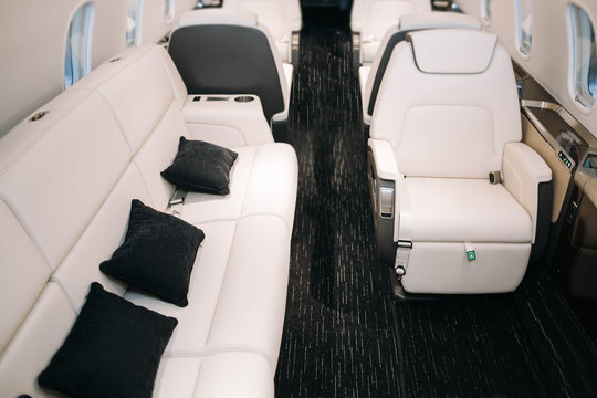 Business jet plane interior with leather seats and sofa